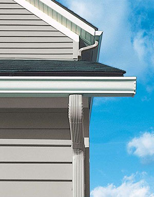 new gutters and downspouts from McCann Window